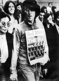 John Lennon during an anti-Imperialist protest holding a pro-IRA poster. (John Lennon being part Irish also) Bobby Sands, Northern Ireland Troubles, Civil Rights March, Irish Republican Army, The Ira, John Lennon And Yoko, Erin Go Bragh, Ares, Before Us