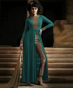 "http://www.istyle99.com/Salwar-Suit/Turquoise-Semi-Stitched-Georgette-Party-Wear-Salwar-Suit-7826.html Turquoise Semi-Stitched Georgette Party Wear Salwar Suit -Rs973 Stitch Type: Semi-stitched Top Colour: Turquoise Bottom Colour: Beige Dupatta Colour: Beige Kameez Fabric: Georgette Bottom Fabric: Unique Brocade Dupatta Fabric: Chiffon CUSTOMIZED UP TO: 44"" Bottom in Mtr: 2 Mtr Dupatta in Mtr: 2.25 Mtr Care Type: Dry Cleanr Work Type: Zari Embroidery Work"