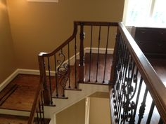 In this Houston area home, we took out the ugly old balusters and put in our fine new wrought iron powder coated ones.  The new balusters, our PC19/1, PC19/2, and PC26/1, all in the Midnight Bronze color, give the staircase a sense of style and gravitas that the original wood balusters just couldn't hope to match.