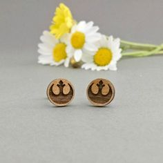 Star Wars Rebel Alliance Earrings Laser Engraved  Join the Rebels! These Rebel Alliance earrings are made from real Alder wood that is sustainably sourced from the USA. They have a nice deep etching that provides great contrast. The earrings are made with Titanium posts, they are hypoallergenic and nickel free. They will be carefully packaged on a brown card and in a kraft jewelry box. Great for gift giving!   Any attack made by the Rebels against this station would be a useless gesture, no…