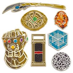 In celebration of Marvel Studios: The First Ten Years, comes this Infinity Stone Saga Pin Set. The limited edition collection of seven enamel cloisonné pins comes in a decorative window display box for safe keeping. Disney Trading Pins, Disney Pins, Superhero Rings, Avengers, Bag Pins, Marvel Clothes, Marvel Cosplay, Stuff And Thangs, Cool Pins