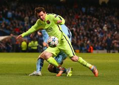 Lionel Messi of Barcelona draws a foul from Pablo Zabaleta of Manchester City in the area to win a penalty during the UEFA Champions League Round of 16 match between Manchester City and Barcelona at Etihad Stadium on February 24, 2015 in Manchester, United Kingdom.
