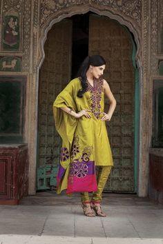 Silk churidar kurta with velvet appliqué work. Priced at $319.