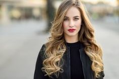 Close-up portrait of young blonde girl with beautiful blue eyes wearing black jacket outdoors. Pretty russian female with long wavy hair hairstyle. Woman in urban background. Body Wave Perm, Beauty Tips For Girls, Blonde Wavy Hair, Beautiful Blue Eyes, Find Girls, Blonde Women, Vegan Beauty, Blonde Color, Hair Color