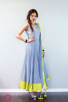 A sprightly anarkali with a cornflower grey/blue embroidered bodice andparrot-green silk border. *** Please note that bodice patterns may vary based ontime of order & fabric availability at market. This piece comes with 3 - 4 inches of additional margin built into the in-seam to take out & go up 1.5 - 2 dress sizes. Please allow 6 - 8 weeks for this item to ship. If you need the piece sooner, please feel free to send us a note to see if we can accommodate a rush order.