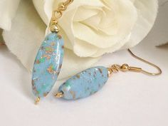 Handmade Blue Speckled Dangle Drop Earrings with Gold Vintage Bead on Etsy, $12.00