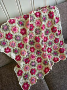 Let your fingers do the walking: African flower blanket. Link to pattern for both the full and the half motif.