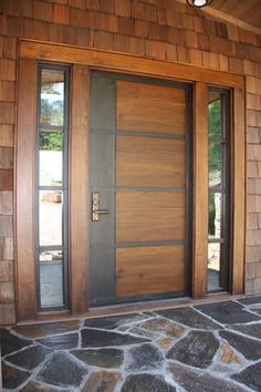 Welcome to the O'Brien House. Entry Door by Appalachian Woodwrights. Door is fire rated, operates with a lever door handle, a peep hole and is to be installed with a low threshold. Side light panels to have opaque glass. Front entry walk is inlaid stone with very slight incline to door. - UD Principle #1 Equitable Use, #6 Low Physical Effort, #7 Space Appropriate for Use.
