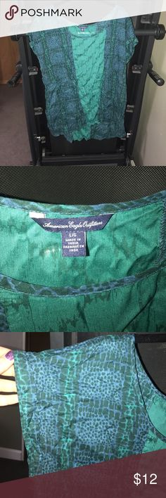 American Eagle Blouse American Eagle Size L Blouse. A little wrinkled. Only worn once. It's a beautiful blue & green print. American Eagle Outfitters Tops Blouses