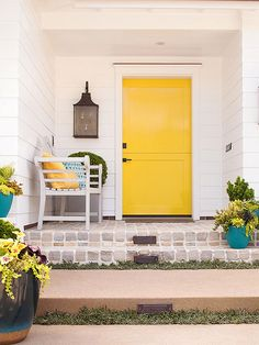 Update: Friendly Front Door. If your front door hides in the shadows, use color to bring it forward. Bold, look-at-me yellow instantly grabs attention and signals the point of entry on this refreshed ranch home.
