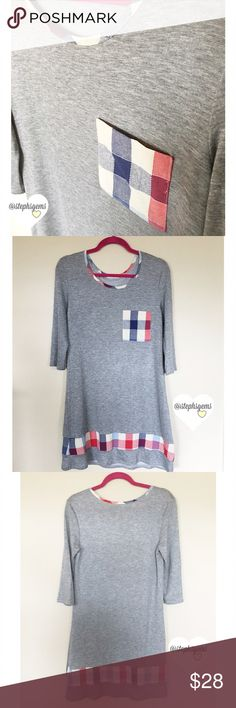 """Gray Sweatshirt Dress with Plaid Pocket and Hem This adorable and comfy 3/4 sleeve gray sweatshirt dress is a great transition piece to style you from summer to fall! Wear as a dress or over leggings as a tunic. Would look great with boots! Super soft! Only one available! Size Small. 34"""" length, 32-34"""" bust. Made in USA.           🌟 Brand NEW item!  🚫 No Trades 💖 Packaged with Love! Dresses"""