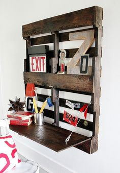 This sort of rustic project isn't for every taste. But if pallets suit your design palette, you just might love this ridiculously easy DIY project that turns a utilitarian wood shipping accessory into a compact fold-down desk perfect for a hallway or bedroom.