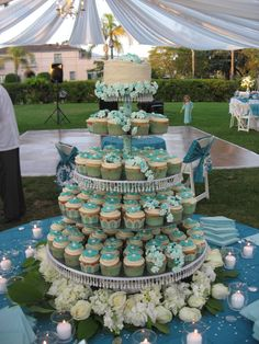 Cupcake tower with small cake on top for cutting ceremony- not a fan of the colors, but this is the idea!