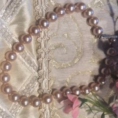 "Vintage Bracelet Vintage bracelet has a beautiful pink/Gray tone. Knots are in between each pearl. 13""L. Jewelry Bracelets"
