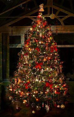 The best kind of Christmas tree - filled to maximum capacity with zillions of decorations!! :D
