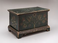 Grayson County,  Virginia  Date Made: 1825-1850 Medium: tulip poplar MESDA accession Number: 5898 Description: This bright and boldly paint-decorated box, featuring yellow and red floral designs over a deep green field, was made for Dr. William Marshall Mitchell (1825-1888). This box is part of a recently discovered group of similar boxes made in Grayson County during the second quarter of the 19th century. This example is the only one with both a name and a date.