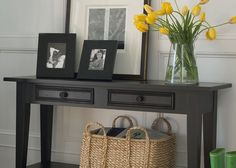 Nothing says farmhouse style more than fresh-cut flowers, family photos, and simple, well-made furniture.