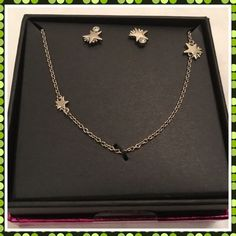 Coach Silver Shooting Star Earrings & Necklace NWT This is a brand new with tags Coach Box Shooting Star Set.  Silver-tone necklace and stud earrings.  Style F90813.  Comes in a Coach gift box. Coach Jewelry