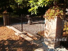 A pretty sunset shot with our Victorian Hoop style iron fence paired with stone pillars and a paver stone knee wall