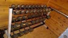 Set of iron dumbells with rack