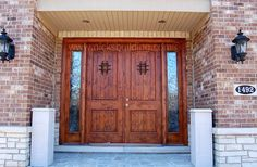 Alder Double Front Door With Side Lites. Double Door With Two Sidelites. Southwestern Double Doors. Double Doors for Brick Home at www.nicksbuilding.com #exteriordoubleentrydoors #wroughtironarcheddoubledoors #knottyalderdoors #exteriordoorswithglass