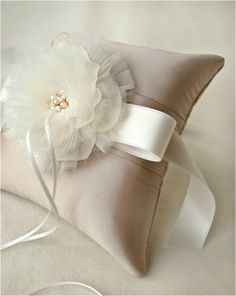 I don't like the wide ribbon bow under the flower, but the 2 fabric flower is pretty and the pearls in the middle