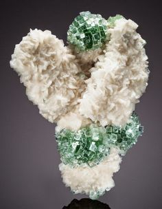 """This mineral beauty, dubbed the """"snow angel,"""" was discovered during the digging of a well in India. The specimen is a silicate mineral called apophyllite-(KF), which appears in volcanic rocks."""