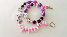 Barrel Beaded Necklace. Flat Round Black And White Shell Beading. Pink And Black Crystals With A 925 Sterling Silver Dragonfly Clasp.