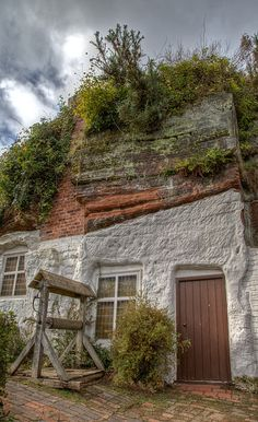 Holy Austin Rock, Kinver, Staffordshire. Homes in the rock. From the 1600's until the 1960's whole families lived comfortably in cave dwellings hewn into the soft sandstone along Kinver Edge. The rock houses here at Holy Austin Rock are among the finest in Europe. Eleven families lived here in a warren of whitewashed rooms on three levels. Now looked after by The National Trust.