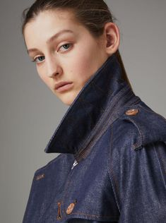 A #Burberry trench coat in raw cobalt denim, kept casual with a relaxed fit