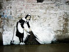Banksy- how we sweep things under the rug and hide them.