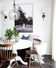 Dining  Furniture Ideas :     White pedestal table, wood chairs,sconces, b&w art    -Read More –
