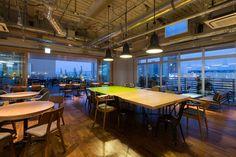 naruse inokuma architects creates open work space with KOIL in japan - designboom | architecture & design magazine