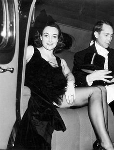 Joan Crawford with her second husband Franchot Tone leaving a party in 1938.