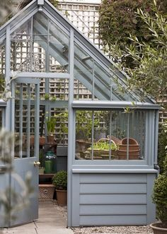 Wouldn't you love one of these at the back of your garden? Painted wooden greenhouse by Marston & Langinger
