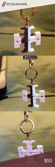 Nwot Tory Burch resin key fob Nwot Tory Burch resin key fob with gold hardware. Front is burgundy pink and white, back is pink. Never been used. Tory Burch Bags