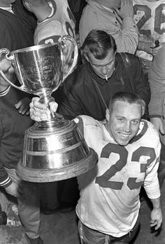 All-time great QB Ron Lancaster in the Saskatchewan Roughriders' locker room in Vancouver after the 1966 Grey Cup victory Sport Football, Baseball, Saskatchewan Roughriders, Canadian Football League, Grey Cup, Raiders, Green Colors, Vancouver, Old School
