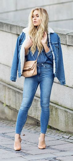 Angelica Blick dares to wear triple denim in this shirt, jeans, and shearling trim jacket outfit.   Jacket: Unknown, Jeans: Monki, Shoes: Zara.
