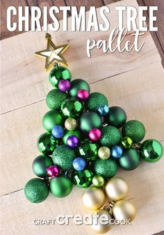 Grab some inexpensive plastic ornaments and a few pallet boards and you can make this pallet Christmas tree that is guaranteed to never drop needles! for christmas Christmas Tree Bulbs, Pallet Christmas Tree, Christmas Tree Crafts, Christmas Wood, Christmas Activities, Christmas Balls, Homemade Christmas, Christmas Projects, Holiday Crafts