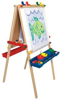 Amazon.com: Melissa & Doug Deluxe Standing Easel: Toys & Games  $49.99  Easel height is adjustable
