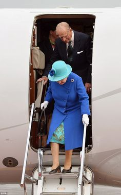 The Queen makes her way out of the plane as she arrives at Tegel airport