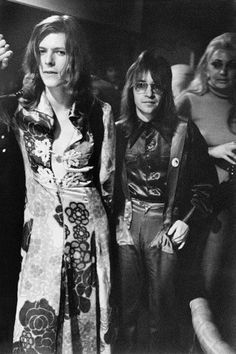 David Bowie's first trip to the US.  In the Man Who Sold the World dress.  With Rodney Bingenheimer.