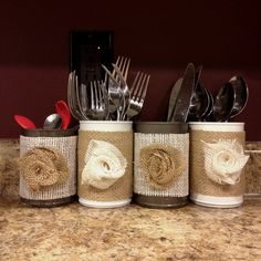 Guess this is a good way not to mix utensils in a drawer.....  Burlap decorated cans for displaying silverware
