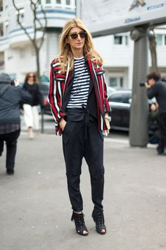 Tee with black pants, booties, and a colorful striped blazer.