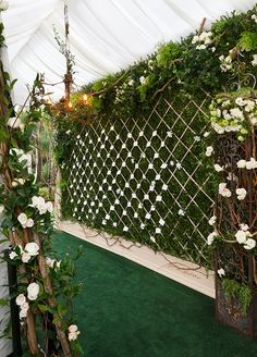 "Guests in black tie found their escort cards on a gorgeous ""live wall"" created by the Colin Cowie Celebrations team."