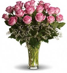 Sending pink roses and white limonium arranged in a glass vase to the woman you love shows that you know how much fun love...