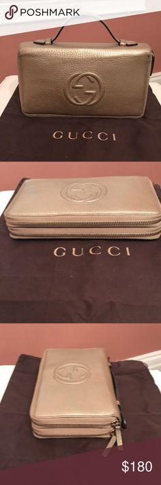 Gucci large double sided double zip wallet Gucci large double side double zip light gold wallet with soft leather handle on top. Excellent condition. Gucci Bags Wallets