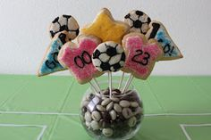 Cute idea to hold cookie pops - diy from Kims Kandy Kreations: Soccer Cookie Bouquet Football Cake Pops, Soccer Cookies, Cake Pop Bouquet, Cookie Bouquet, Cookie Pops, Soccer Party, Dessert Table, Holiday Parties, Party Favors
