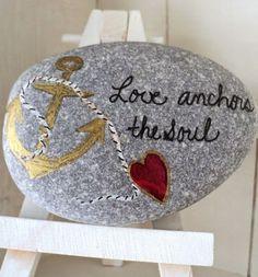 Love anchors the soul. Written on a beach rock.
