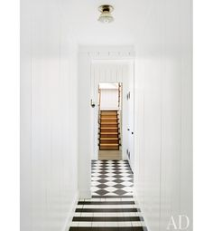 love this fresh, crisp painted black and white floor  featured in Architectural Digest.